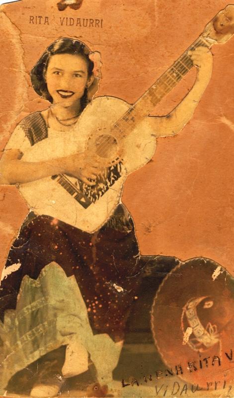 Rita with guitar.