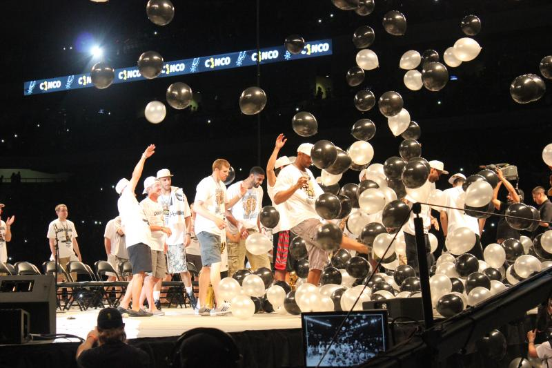 Spurs Matt Bonner and Tim Duncan kick balloons released from the ceiling.