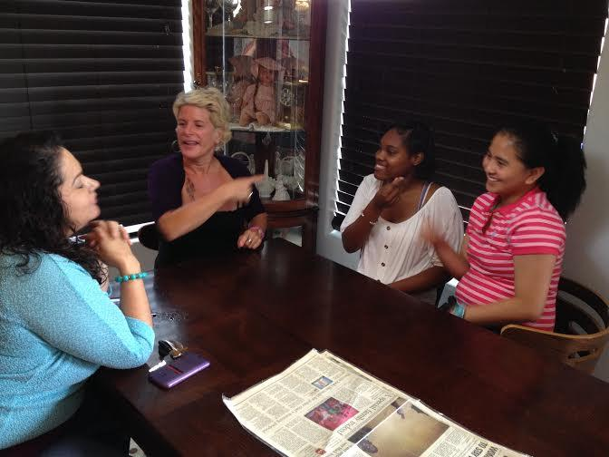 (Right to left) Nicole Linsangan signs with her host sister and mother, Terisha and Carol Ann Broderson, with her former teacher, Gabriella Wolfenberger.