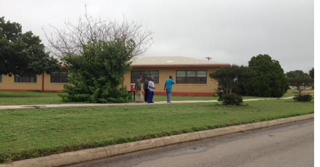 Residents outside a housing unit of the San Antonio State Supported Living Center.