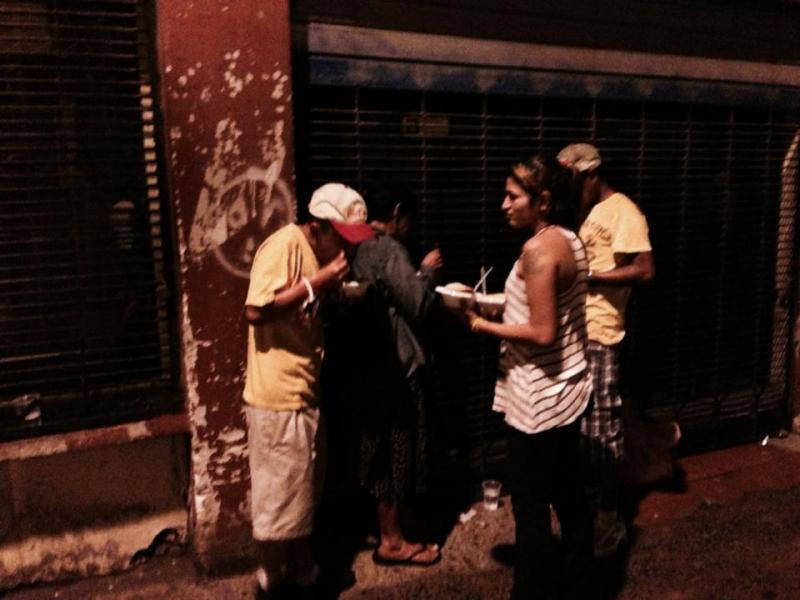 Youth in Honduras gathering around to share a free meal.