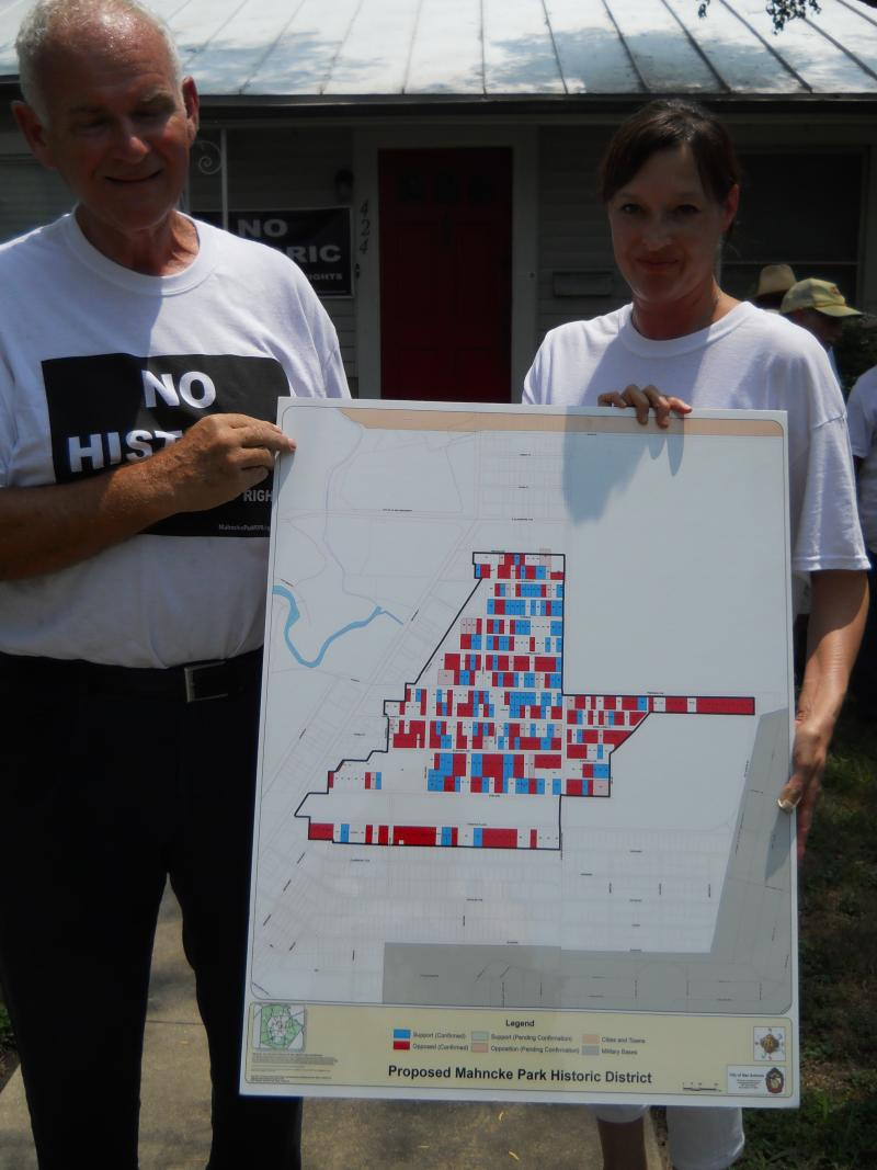 Heather Clark (right) shows map of Mahncke Park Historic Designation District. She says homes in red are opposed to the plan.