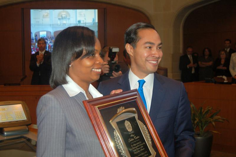 Mayor Ivy Taylor presents former Mayor Julián Castro with a plaque commemorating his service to the city of San Antonio.