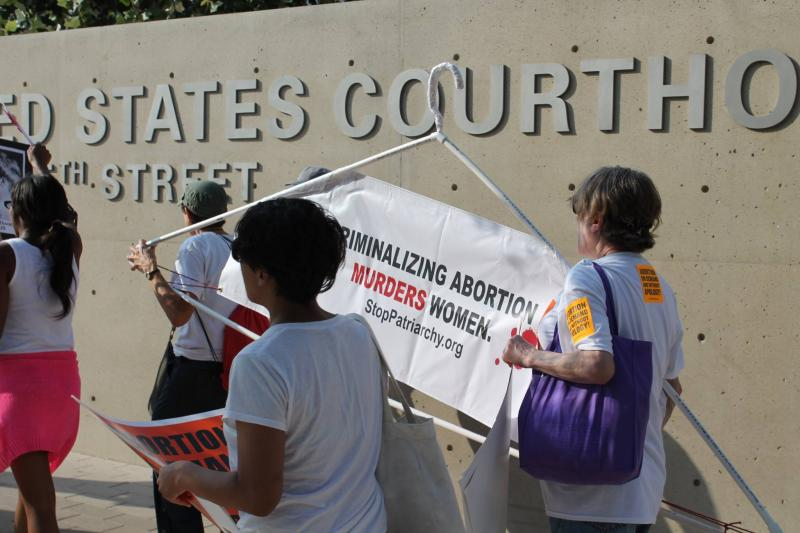 Abortion-rights supporters rally outside the Austin federal courthouse.