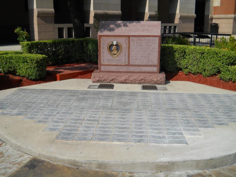 Purple Heart memorial at the Cadena Reeves Justice Center in San Antonio was first dedicated in 2006. Names have been added over the years and the memorial today contains more than 400 pavers representing Purple Heart recipients.