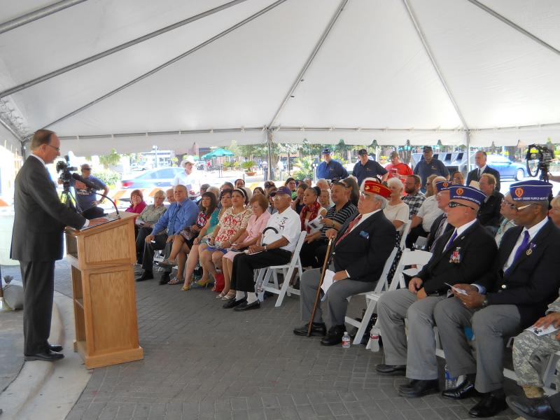 Officials from Bexar County join Military Order of the Purple Heart Alamo Chapter 1836 and U.S. Army officials to commemorate new names added to the county's Purple Heart Memorial.