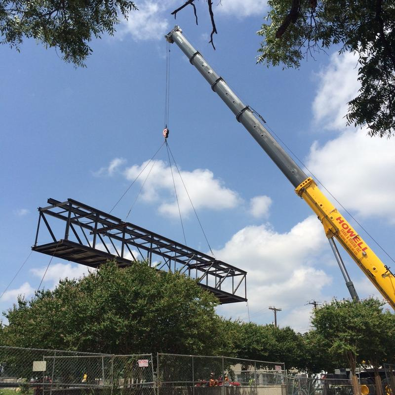 """The San Antonio River was closed to foot traffic as well as barges as the 35,000-lb. 1970s-era bridge was """"flown"""" into place by this crane."""