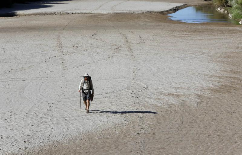Colin McDonald walks along the riverbed of the Rio Grande on his way to the Texas state line.