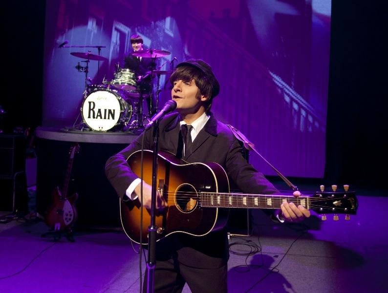 Rain performing, Jim Irizarry as John Lennon