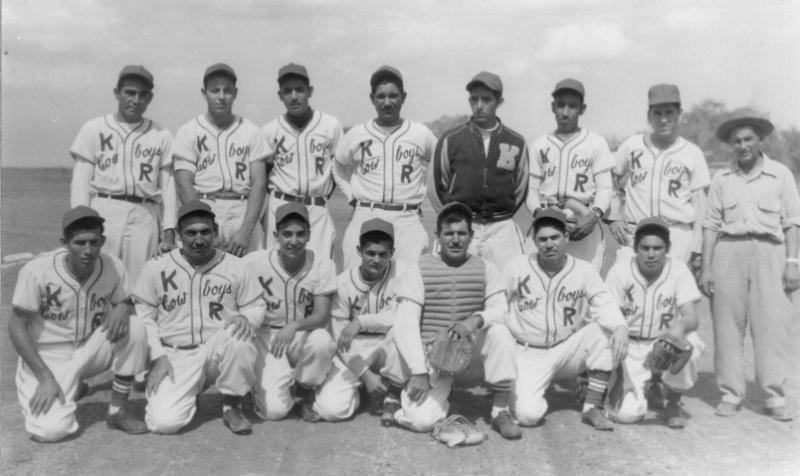 This is the King Ranch Cowboys team of 1952.  The team is made up of the cattleman that worked the ranch.  They are famously known as the Kineños.  For many of the men the game of baseball was their only break from days full of hard work.
