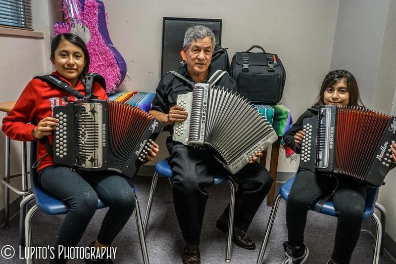 Sisters Jennifer and Janet Suarez with Lorenzo Martinez