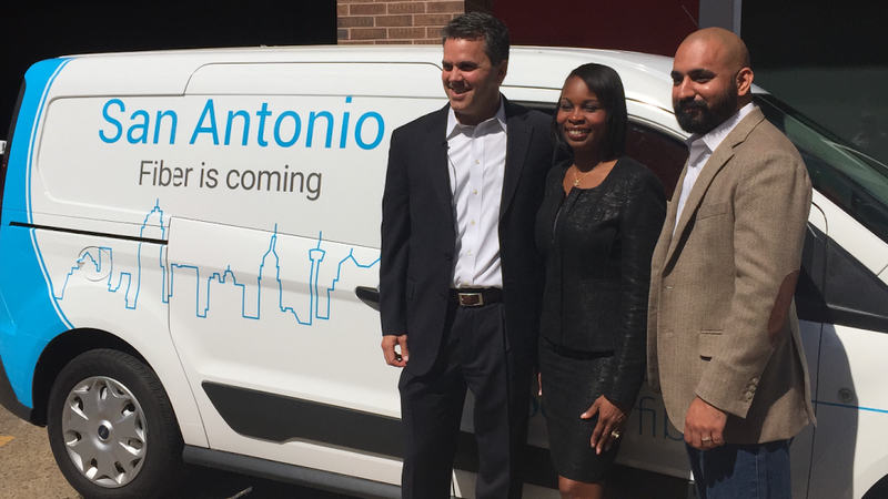 Mark Strama, Head of Google Fiber Texas, San Antonio Mayor Ivy Taylor, and Geekdom Director Lorenzo Gomez pose for a picture with the Google Fiber van