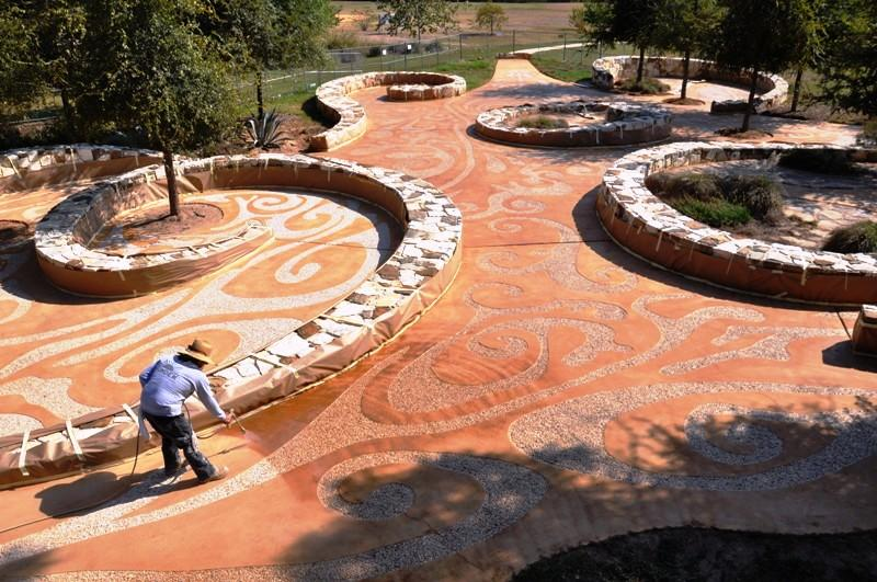 Concrete stainer working on Mission Concepcion Art Portal