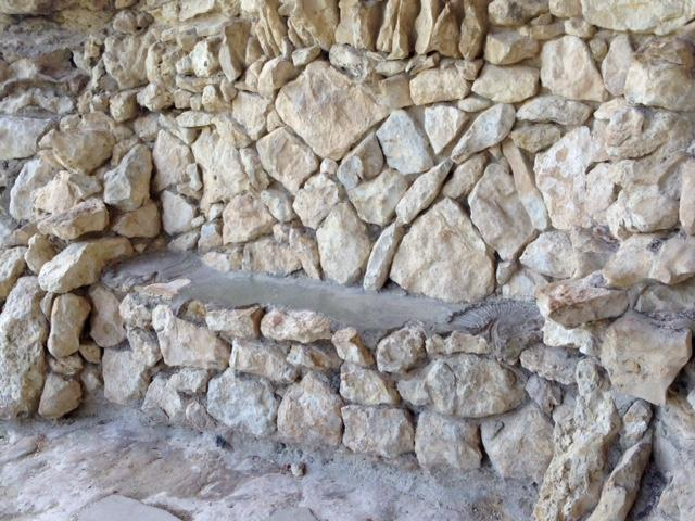 "stone ""couch"" built into a wall"