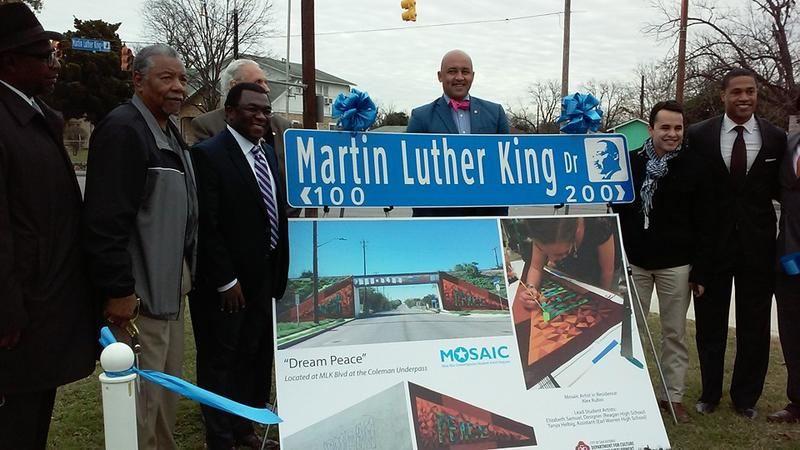 "Among the improvements for this year's MLK March are new street signs for MLK Drive that bear the image of Dr. Martin Luther King, Jr.; banners with quotes from Dr. King; and a mural entitled, ""Dream Peace,"" designed by Mosaic at Blue Star."