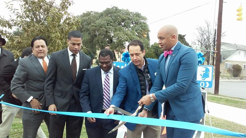 Council member Alan Warrick prepares to cut the ribbon on improvements to the MLK March, joined by (l-r) Brandon Logan, MLK Commission Chairman, Mike Eitenne, Director of East Point and Texas State Senator Jose Menendez