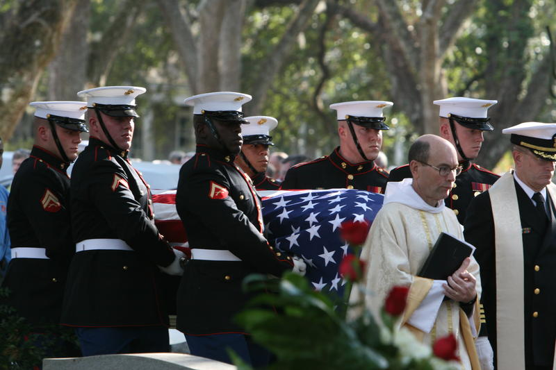An Honor Gaurd Brings A Casket To Its Final Resting Place
