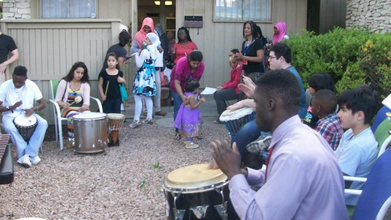 Refugees make music in the courtyard