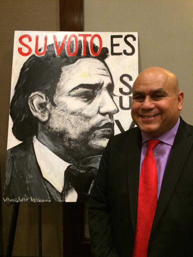 "Antonio Gonzalez, President of the Southwest Voter Registration Education Project (SVREP).  It was founded by ""Willie"" Velasquez, Jr., depicted in poster."
