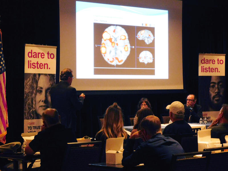 Dr. Peter Fox illustrates brain activity for the audience