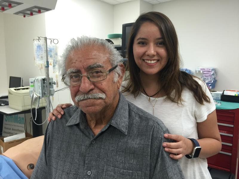 Aneurysm patient Carlos Hernandez and his granddaughter Crysty at the U.T. Health Science Center