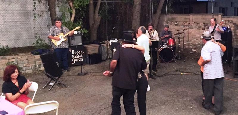 Conjunto band plays in Esperanza courtyard