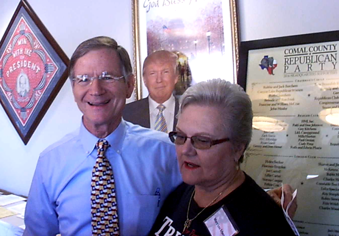 Rep Lamar Smith poses with a supporter at the Comal County GOP Headquarters