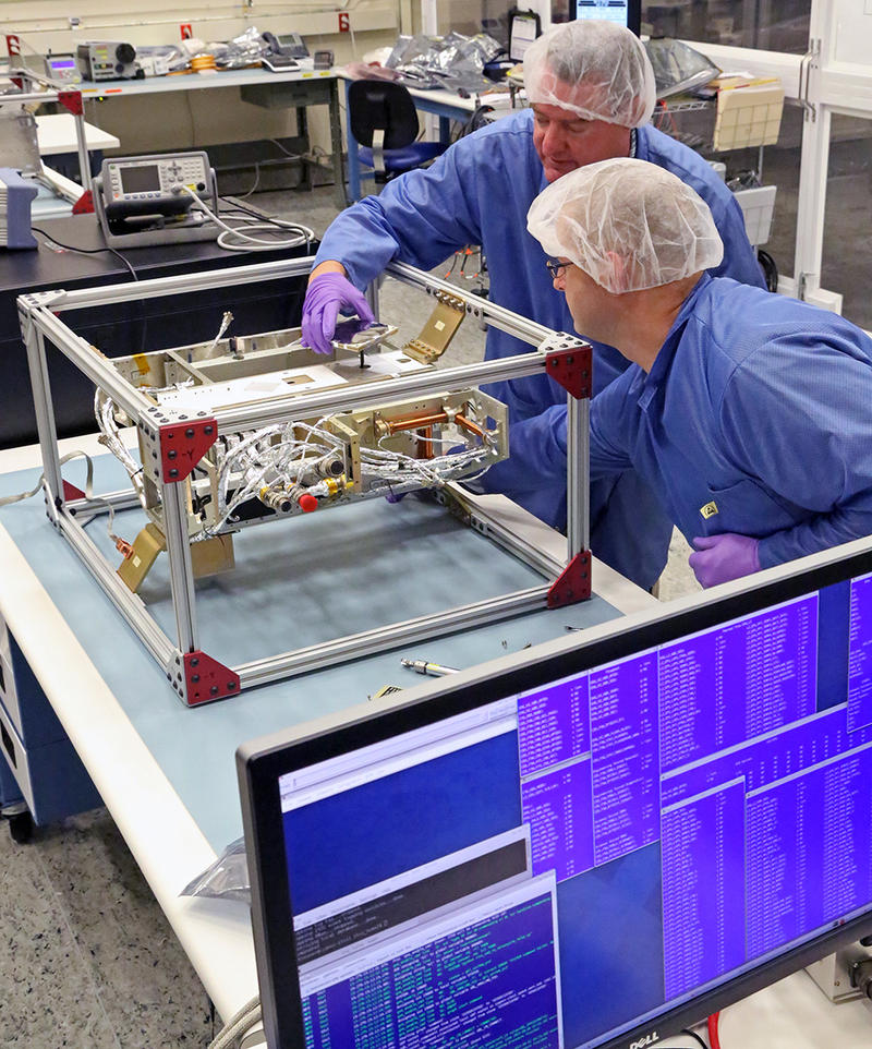 Southwest Research Engineers construct one of their first Satellites.