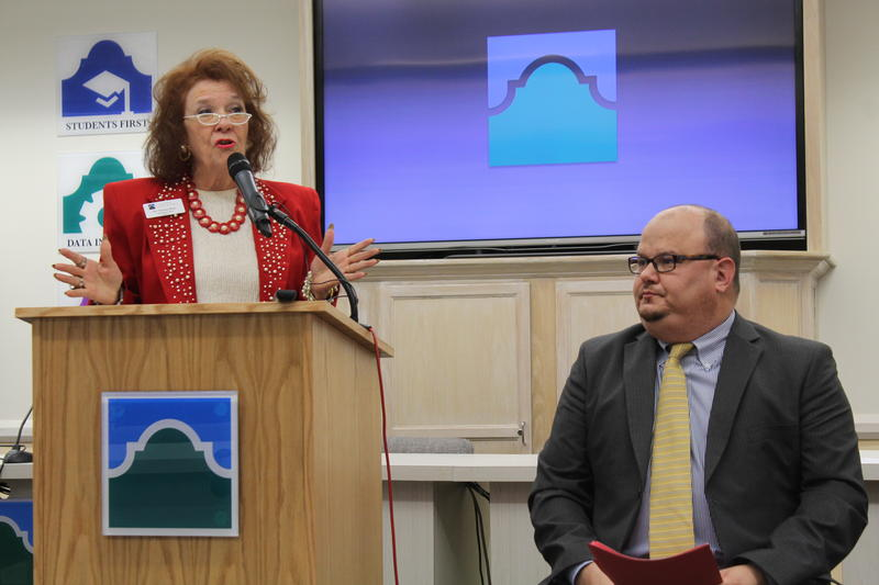 Alamo Colleges Board Chair Yvonne Katz talks to the press following the receipt of a formal letter from the Southern Association of Colleges and Schools. San Antonio College President Robert Vela is seated next to her.