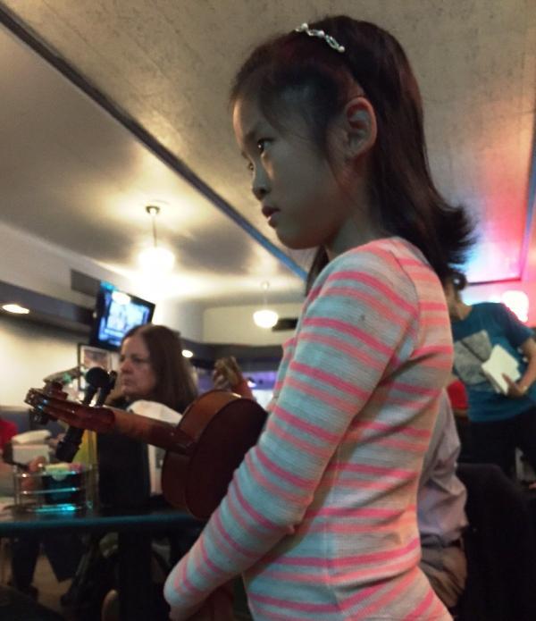 Elizabeth Yao watching musicians