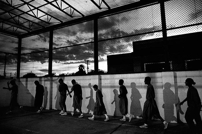 Young inmates march through the prison yard at dawn. After waking up at 4:45 a.m., they begin each day with an hour of physical activity.