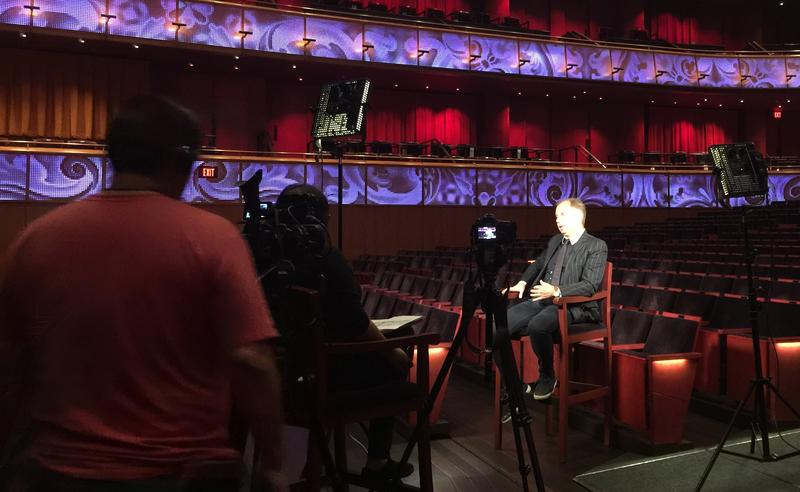Sebastian Lang-Lessing being interviewed at the Tobin Center