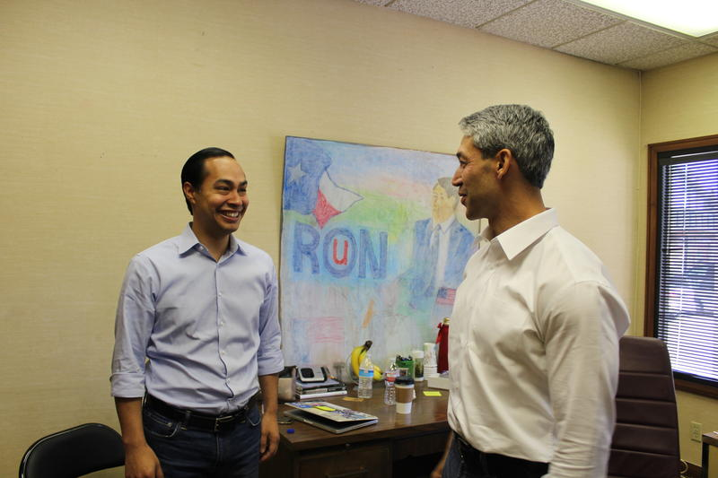 Former San Antonio Mayor Julian Castro talks with mayoral candidate and District 8 Councilman Ron Nirenberg inside campaign headquarters at 1001 Broadway.