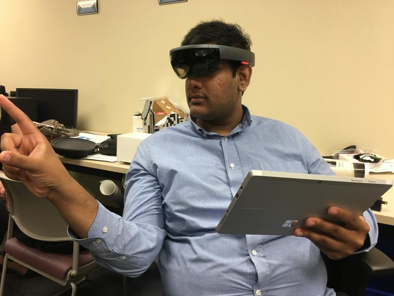 UTSA graduate student Sohail Baig dons the Microsoft Hololens that drives the PerSim technology.