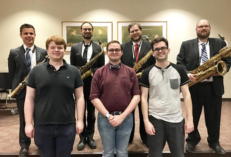 Front row, L to R: Sam Rainey, Peter Fitzgerald, John Carrol. Back row: Bel Cuore Sax Quartet.