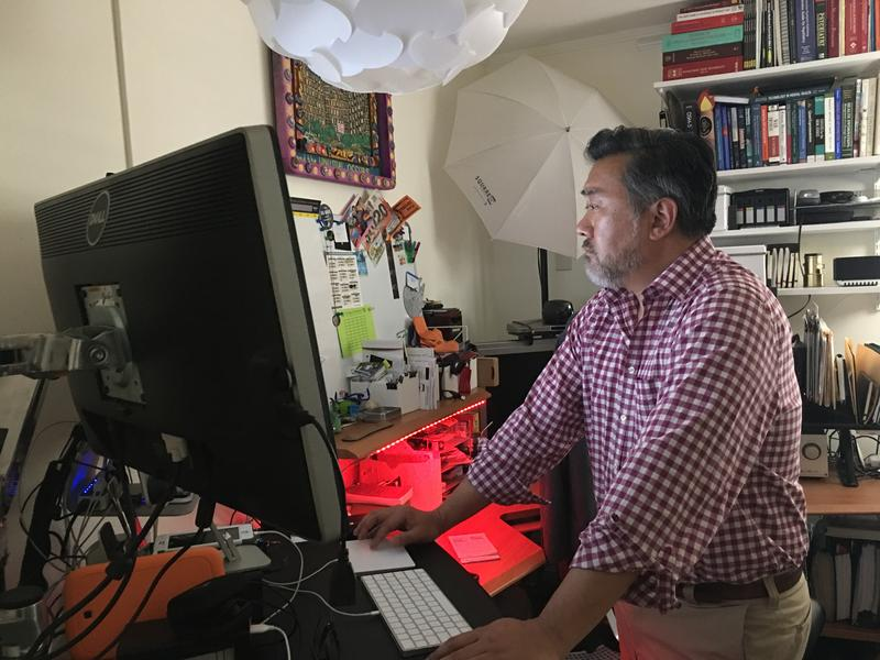 Thomas Kim, MD, treats patients via telemedicine from his home in Austin.
