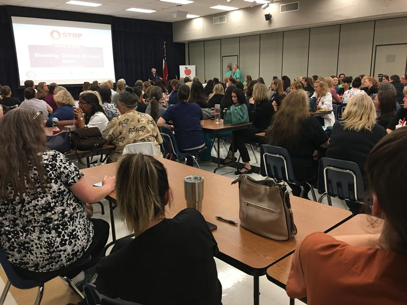 A room full of NISD school nurses learns about stopping bleeding.