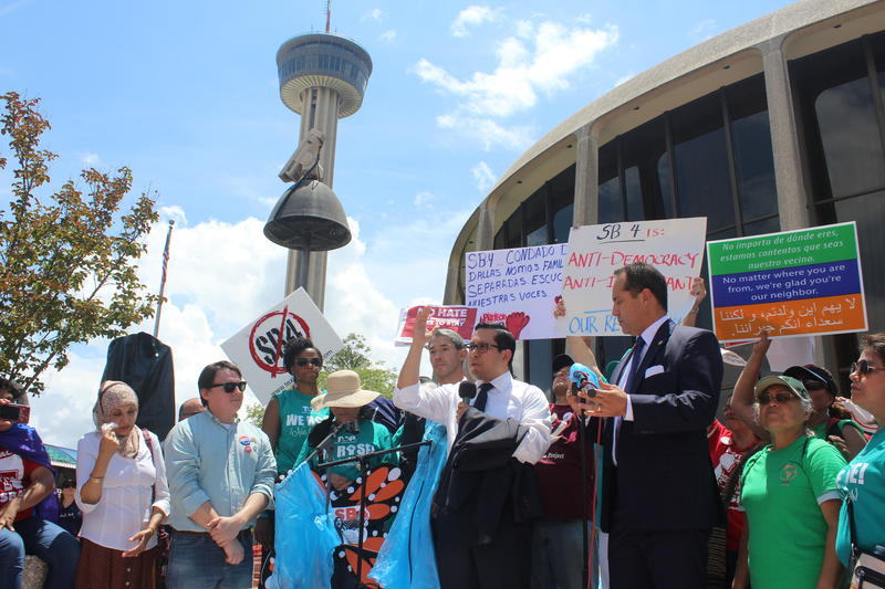 Elected officials join protestors outside San Antonio's federal courthouse last June as the lawsuit had its first day in court.