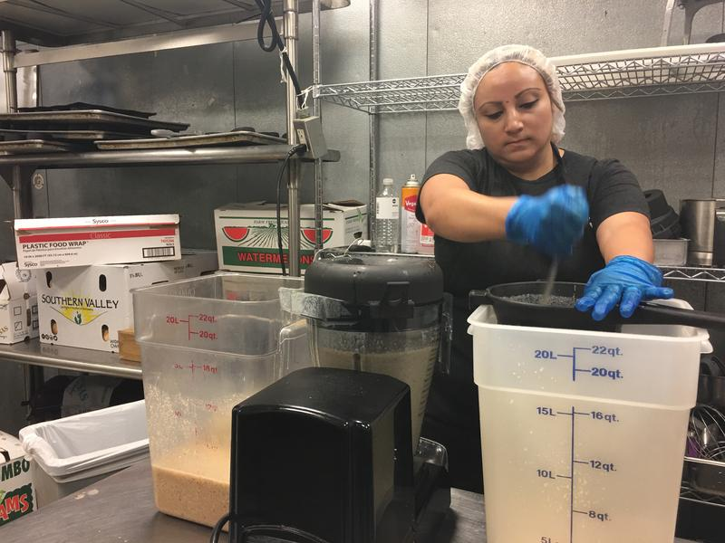 Workers in Snap Kitchens prepare and package thousands of meals for sale.