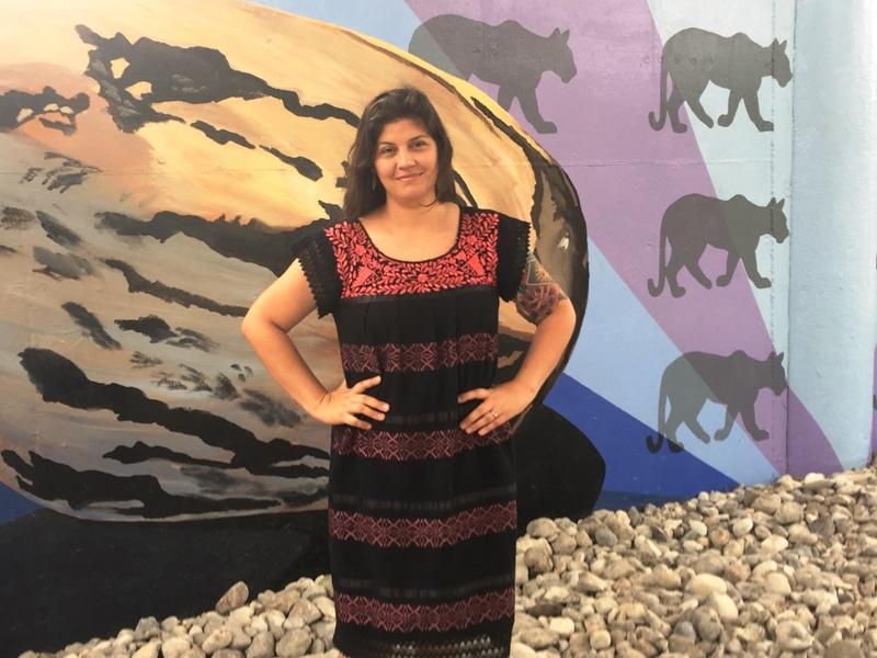 Cristina Sosa Noriega in front of her mural.