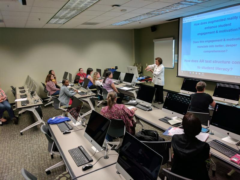 UTSA's Ilna Colemere leads a training event on Augmented-Reality books