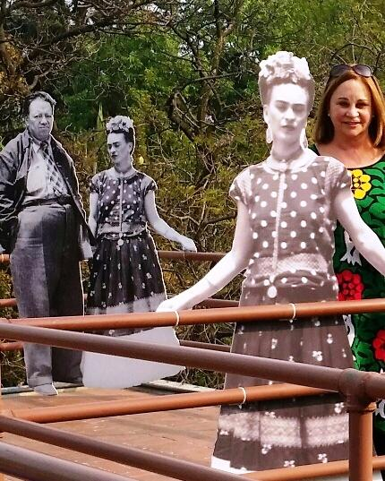 Catherine Nixon Cooke with cutouts of Diego and Frida
