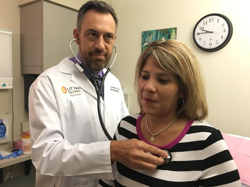 Medical Oncologist Andrew Brenner, MD, takes care of breast cancer patient Lorena Aguilar.