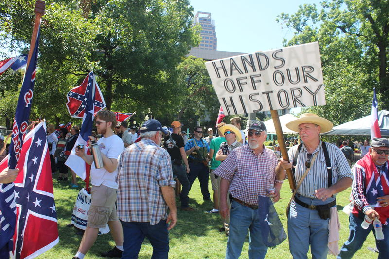 A group of Confederate supporters gathred in Travis Park to voice opposition to removing the confederate monument in its center.