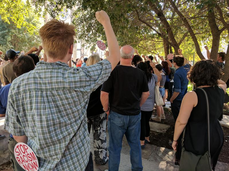 A group of San Antonians Shout Slogans in support of removing the confederate monument in Travis Park