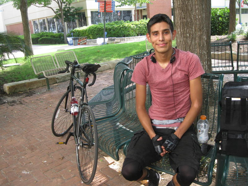 Antonio Martinez cools off after a bike ride to campus.