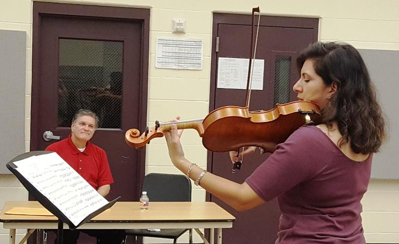 Ronnie Sanders, Claire Haugen at auditions for violinists.