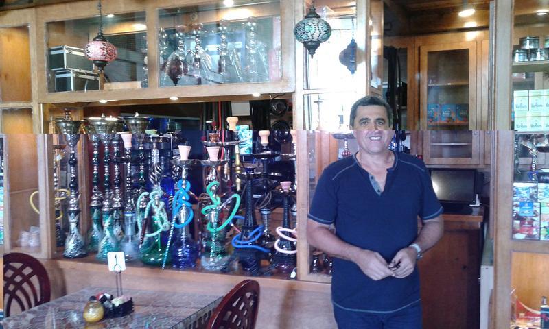 Majid Mehrafza displays the hookah pipes he offers at Naara Cafe in northwest San Antonio.