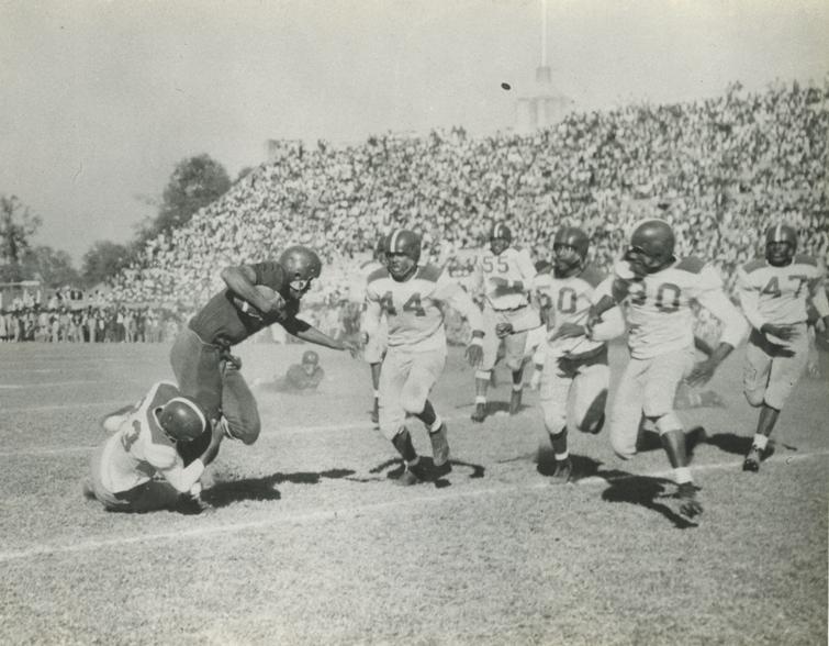 The Houston Phillis Wheatley High School football team at the annual Thanksgiving Day game against Jack Yates High School, Houston, Texas, 1954.