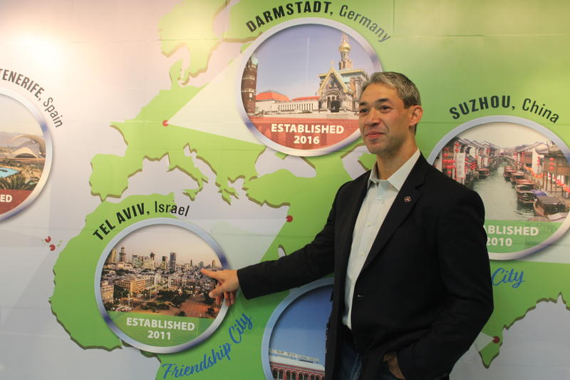 San Antonio Mayor Ron Nirenberg points to Tel Aviv on a mural at the San Antonio International Airport that depicts the city's Sister City relationships. October 20th 2017